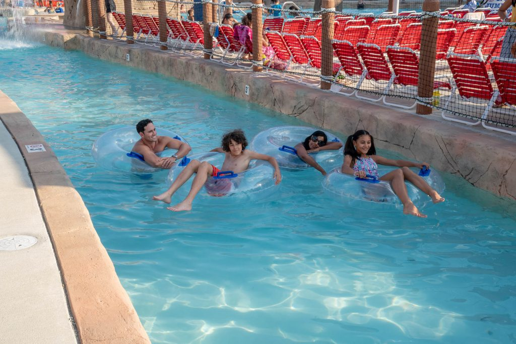Family Floating Down the Lazy River in the Waterpark